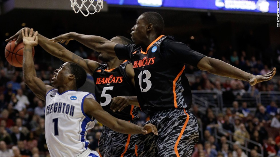 Austin Chatman of the Creighton Bluejays, left, goes up for a shot against Justin Jackson, center, and Cheikh Mbodj of the Cincinnati Bearcats on March 22 in Philadelphia.