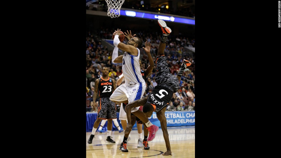 Justin Jackson of the Cincinnati Bearcats, right, fouls Gregory Echenique of the Creighton Bluejays on March 22.