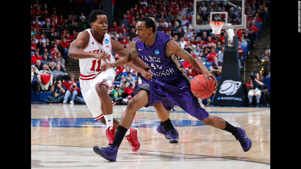 "Devon Moore of the James Madison Dukes, right, dribbles the ball against Kevin ""Yogi"" Ferrell of the Indiana Hoosiers on March 22."