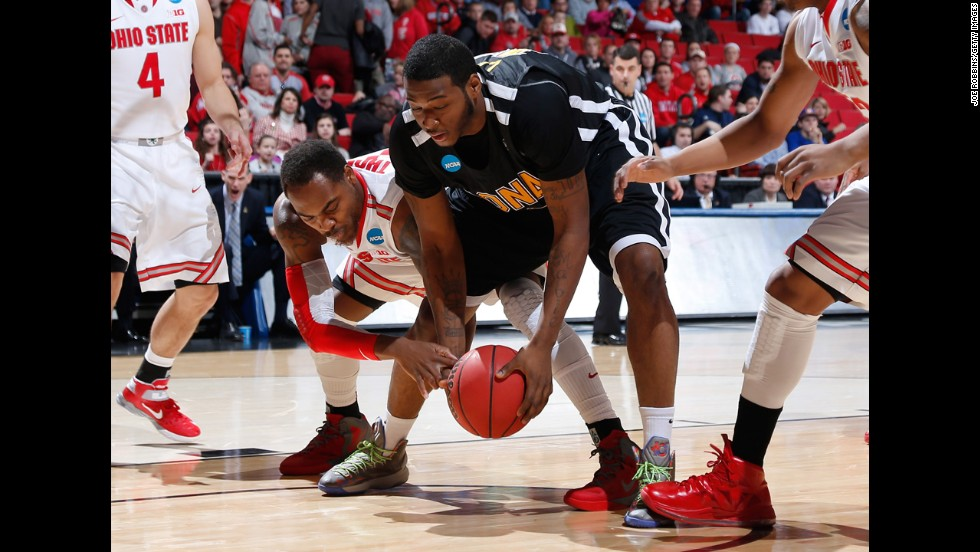 Deshaun Thomas of the Ohio State Buckeyes, left, and David Laury of the Iona Gaels battle for a loose ball on March 22 in Dayton, Ohio.
