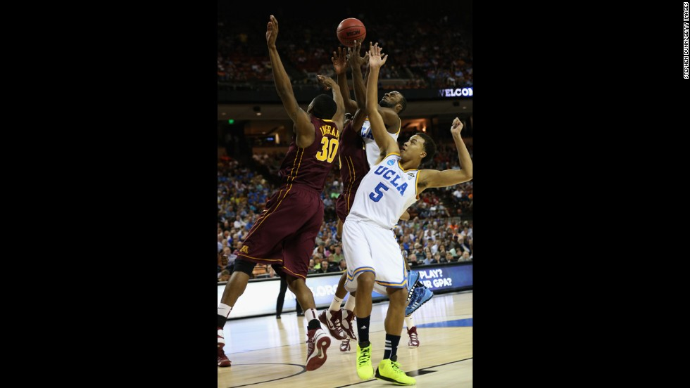 Kyle Anderson, right, and Shabazz Muhammad of the UCLA Bruins battle for the ball against Andre Ingram of the Minnesota Golden Gophers on March 22.