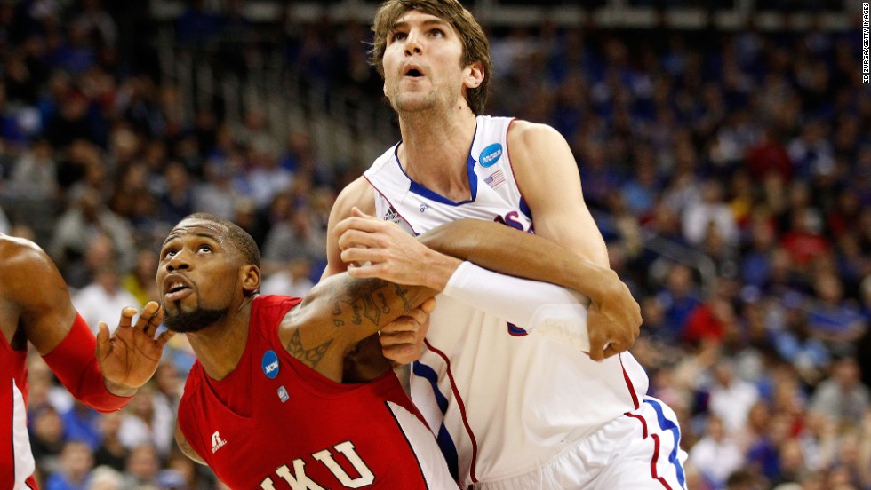 George Fant of the Western Kentucky Hilltoppers, left, boxes out Jeff Withey of the Kansas Jayhawks on March 22.