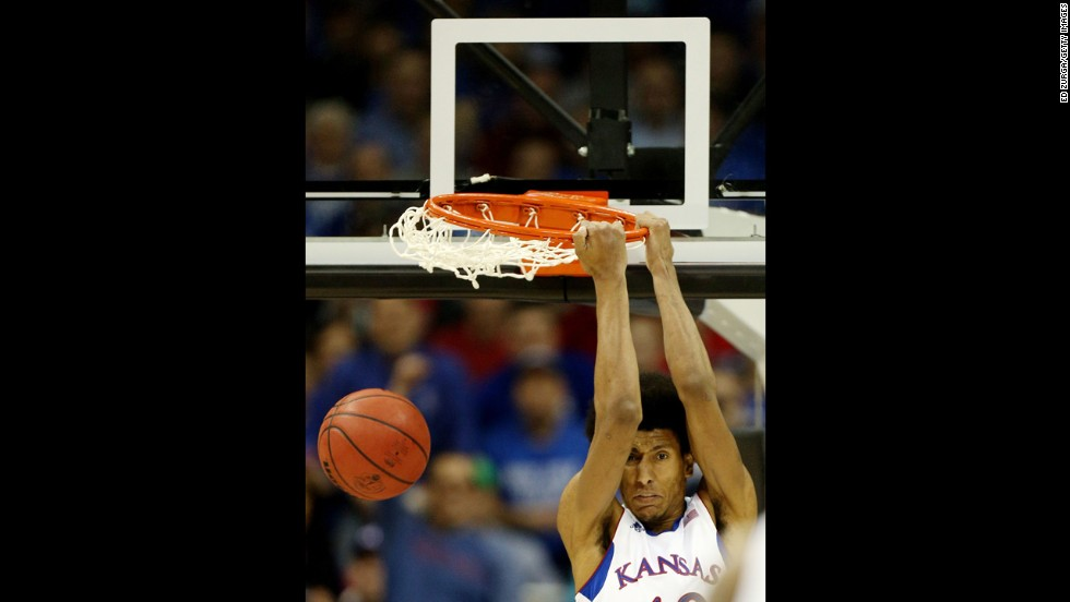 Kevin Young of the Kansas Jayhawks dunks against the Western Kentucky Hilltoppers on March 22.