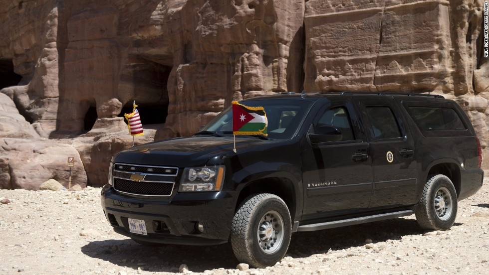 The president's motorcade sits parked on a dirt path as he tours Petra on Saturday.