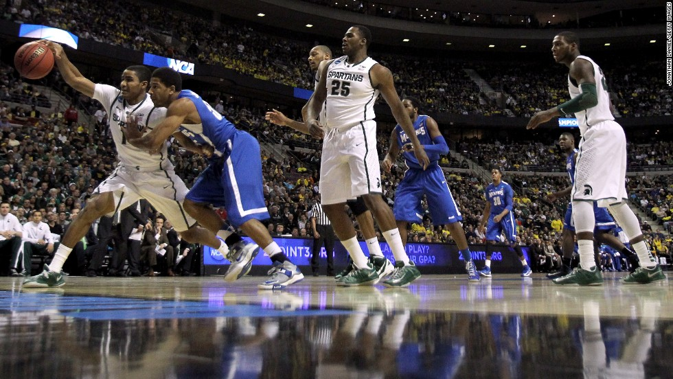 Gary Harris of Michigan State, left, battles Geron Johnson of Memphis for the ball on March 23.