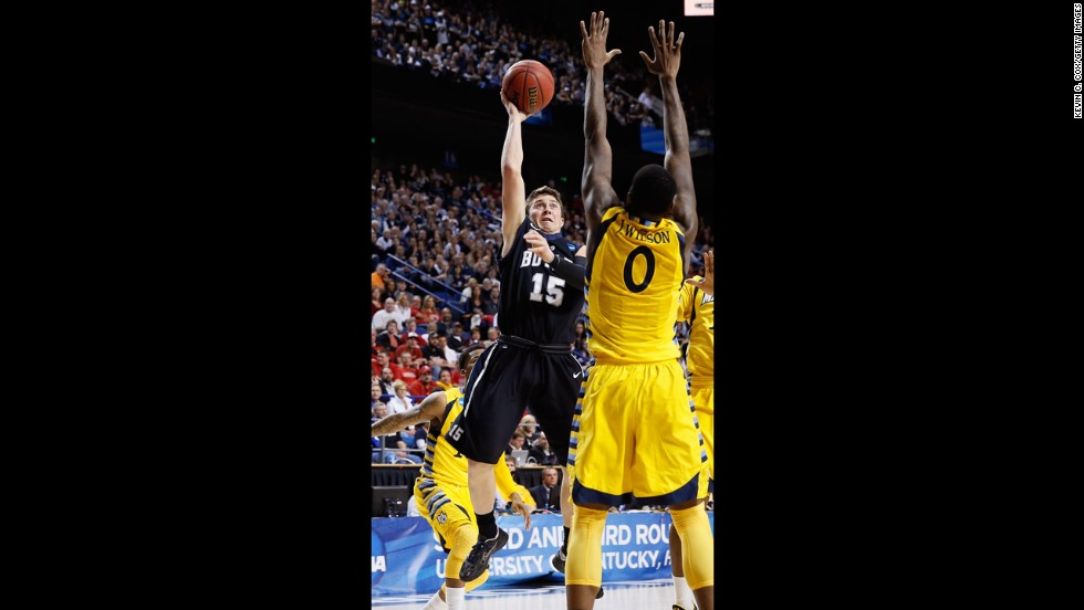 Rotnei Clarke of Butler, left, shoots over Jamil Wilson, right, of Marquette on March 23.
