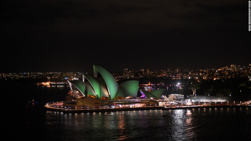 This picture shows the Sydney Opera House illluminated shortly before the start of the annual Earth Hour.