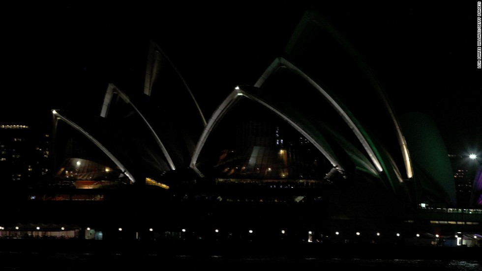 The Opera House is seen after the lights were switched to 'GreenPower' and glowed dark green to recognize Earth Hour.