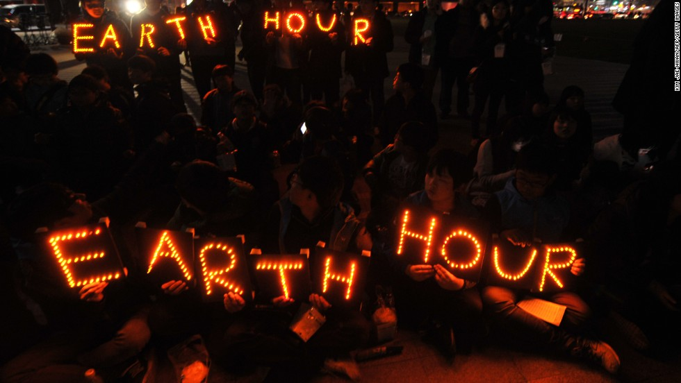 South Korean students hold Earth Hour LED displays during the 7th annual Earth Hour global warming campaign in Seoul on March 23.