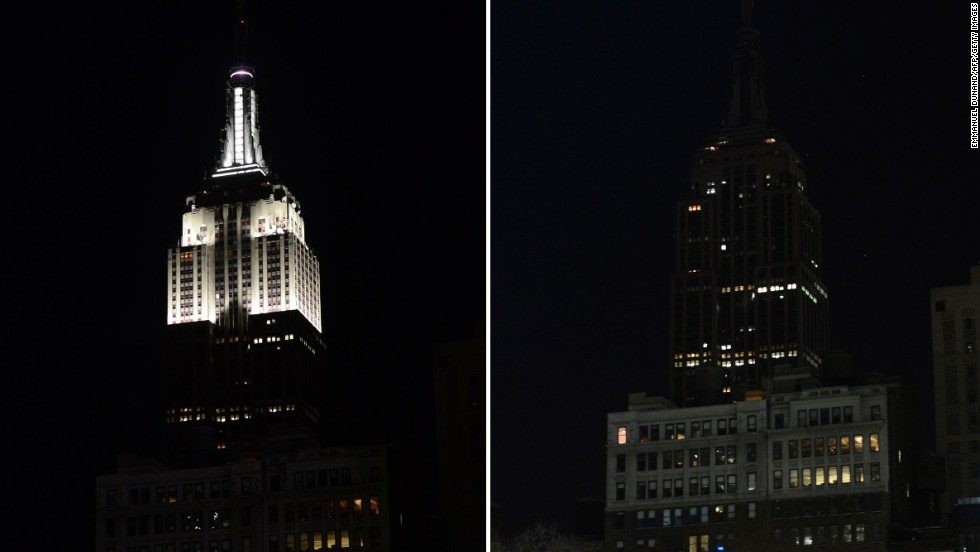 In this combo photo The Empire State Building stands dark as its lights were turned off.