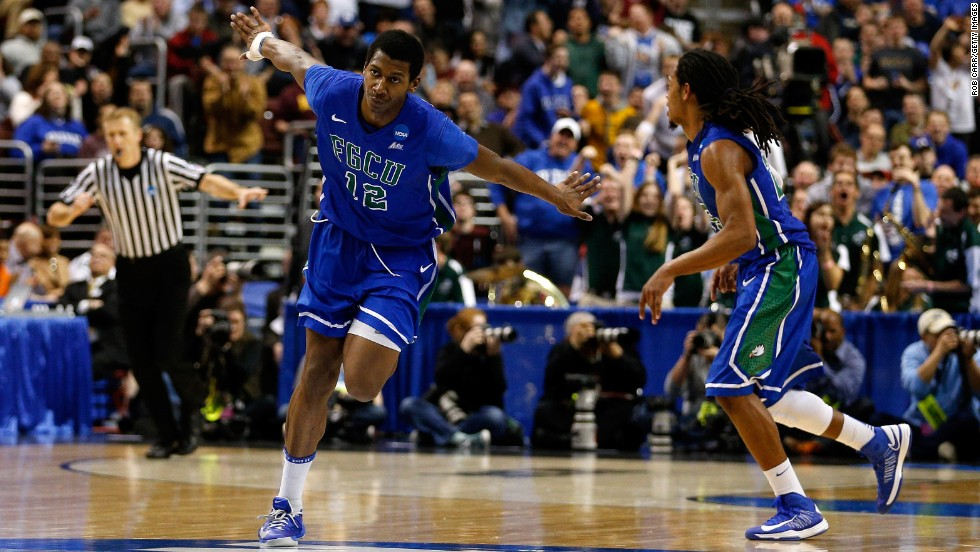 Eric McKnight, left, of the Florida Gulf Coast Eagles celebrates in the second half while taking on the San Diego State Aztecs on March 24 in Philadelphia. Florida Gulf Coast won 81-71.