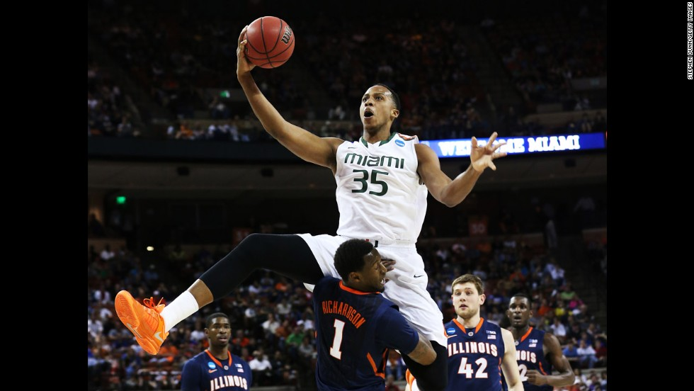 Kenny Kadji of Miami leaps over D.J. Richardson of Illinois on March 24.
