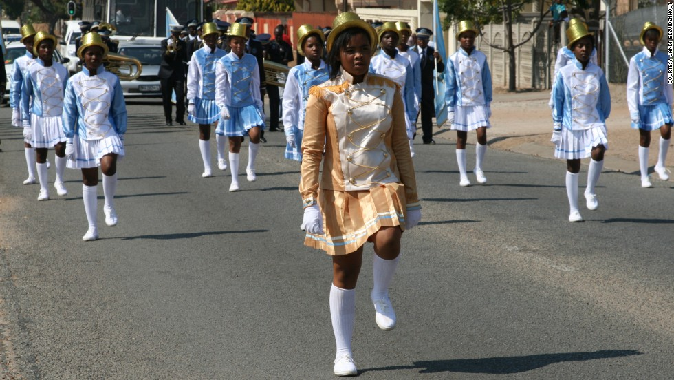 The 20 drum majorettes in the band lead processions. In their school holidays Bezuidenhout teaches some of them needlework so that they can help to make the uniforms.