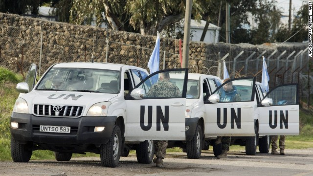 UN peacekeeper vehicles leave the UN headquarters in the demilitarized UNDOF zone in Golan Heights on March 8.