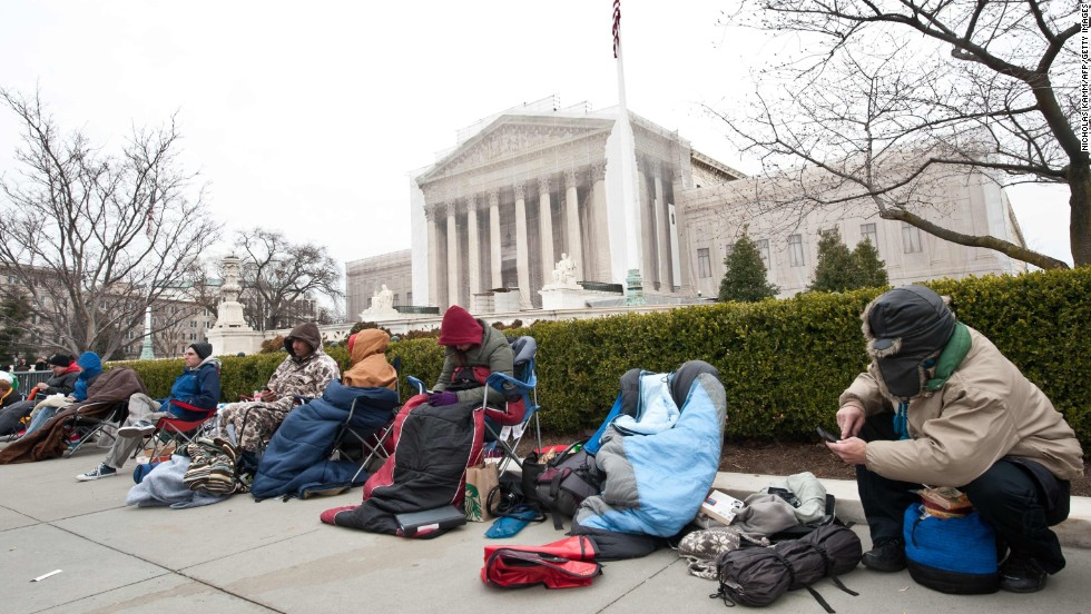 People rest in front of the Supreme Court in Washington on March 24 in the line for the hearing.