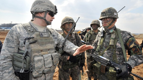 A US Air Force soldier (L) talks to South Korean soldiers during annual joint exercises south of Seoul, on March 14.