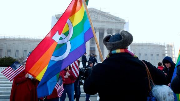 A protester carries a rainbow flag Tuesday.