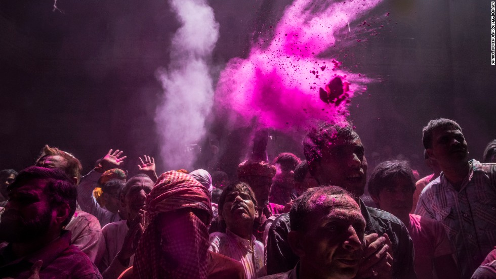 Hindu devotees throw colored powder, known as gulal, during early Holi celebrations at the Banke Bihari temple on Tuesday, March 26, in Vrindavan.