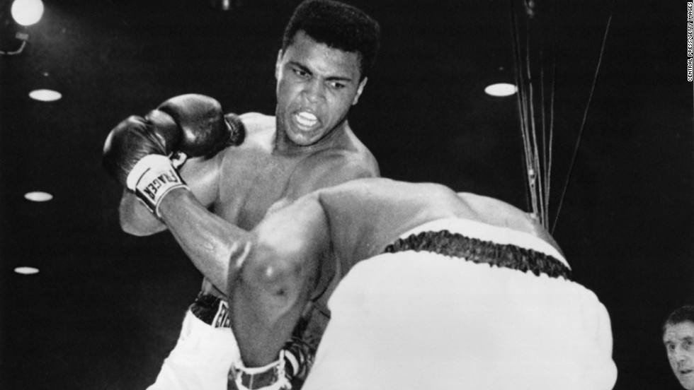 "Muhammad Ali won the world heavyweight championship in 1964 over Sonny Liston. In 1967, after claiming conscientious objector status to military induction during the Vietnam War, Ali was found guilty of refusing induction into the U.S. armed forces. His passport is revoked and the boxing association strips him of his title and effectively bans him from competition for more than three years.  Ali returns to the ring in 1970 and four years later reclaims the heavyweight title belt with a victory over George Foreman in the ""Rumble in the Jungle"" in Zaire."
