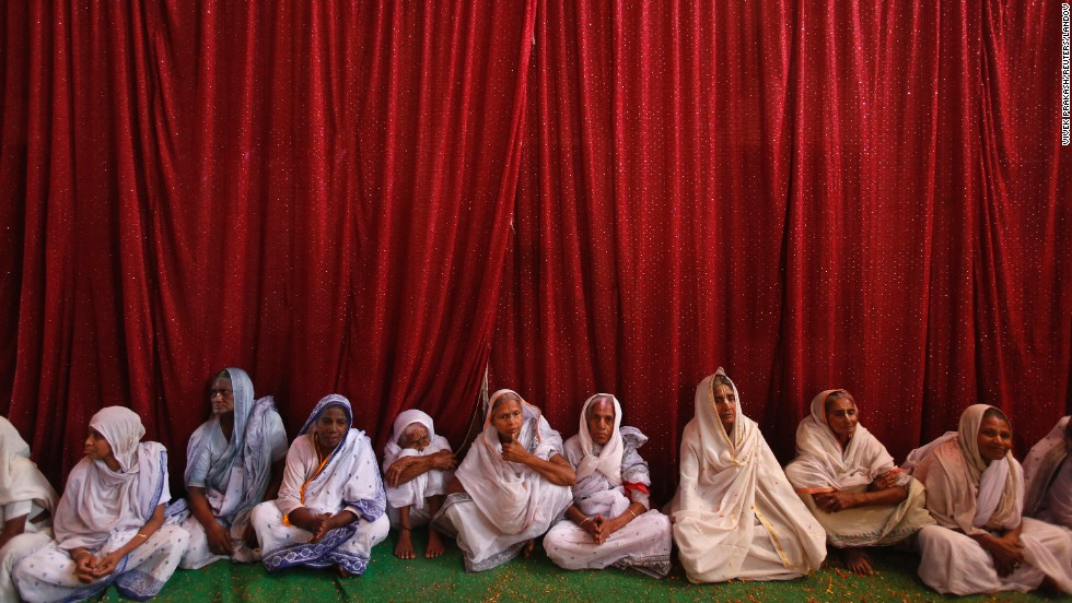 Widows sit on the ground during celebrations at the Meera Sahavagini ashram in Vrindavan on Sunday, March 24. In Hindu culture, widows are expected to renounce earthly pleasure, so they do not celebrate Holi, but for the first time, women at the shelter for widows who have been abandoned by their families celebrated the festival by throwing flowers and colored powder.