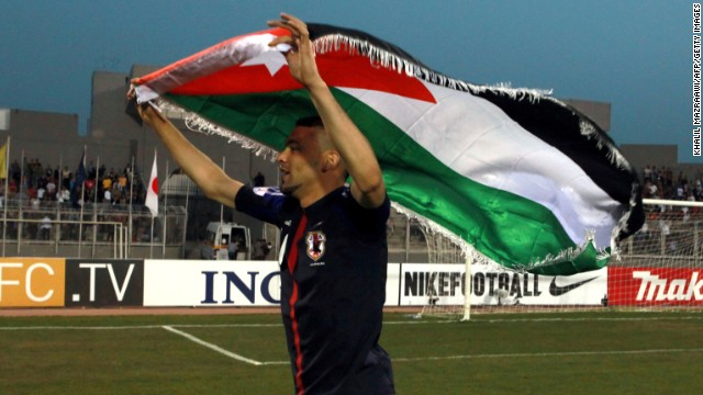 Ahmad Ibrahim celebrates after a 2-1 victory over Japan that took Jordan from bottom of Group B to second on Tuesday.