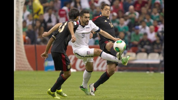 Javier Hernandez of Mexico fights for the ball with two U.S. players.