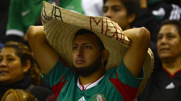 Mexico fans watch the game.