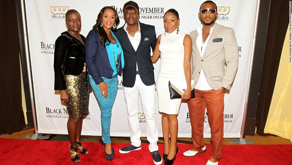 "Angelle Kwemo, Vivica Fox, Jeta Amata, Jeta's wife Mbong Amata and Enyinna Nwigwe (l-r) pose for a photo at the ""Black November ""screening in Washington, on May 8, 2012."
