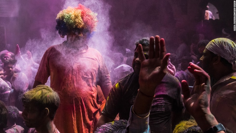 Celebrants throw colored powder on March 27 in Vrindavan.