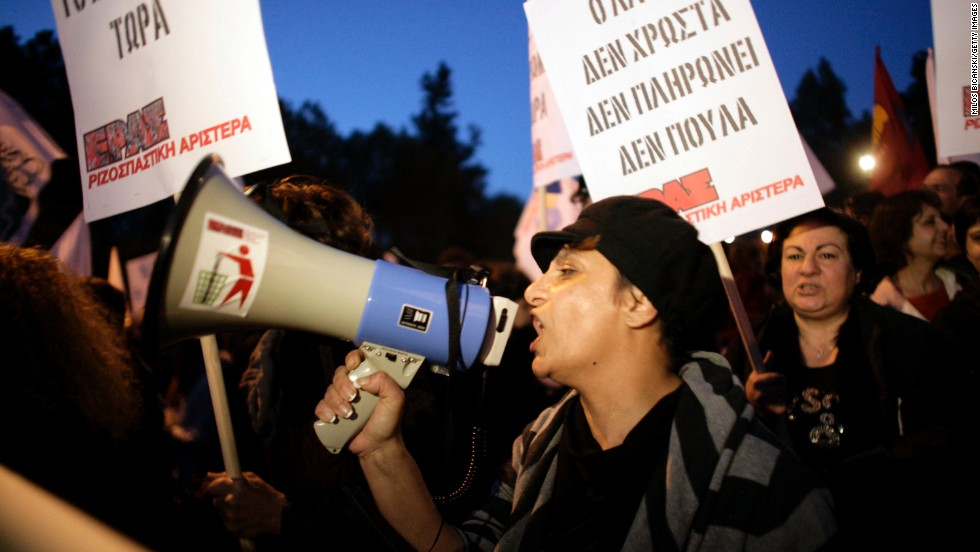 A demonstrator shouts through a megaphone during a protest against austerity measures and the Troika on March 23 2013, in Nicosia, Cyprus. (Photo by Getty Images/Milos Bicanski)