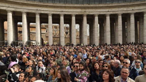Crowds gather as Pope Francis delivers his blessing on Palm Sunday, March 24.