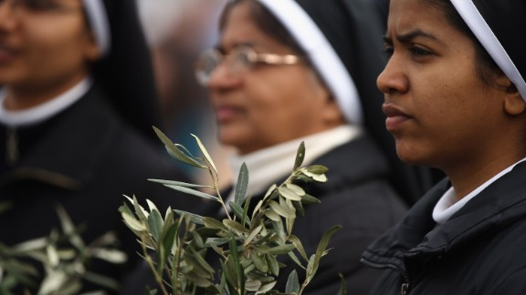 Nuns hold olive leaves on March 24.