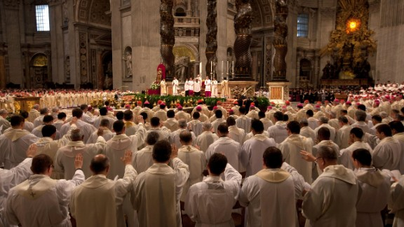 Church leaders signal to the front of the church during the Chrism Mass on Thursday.