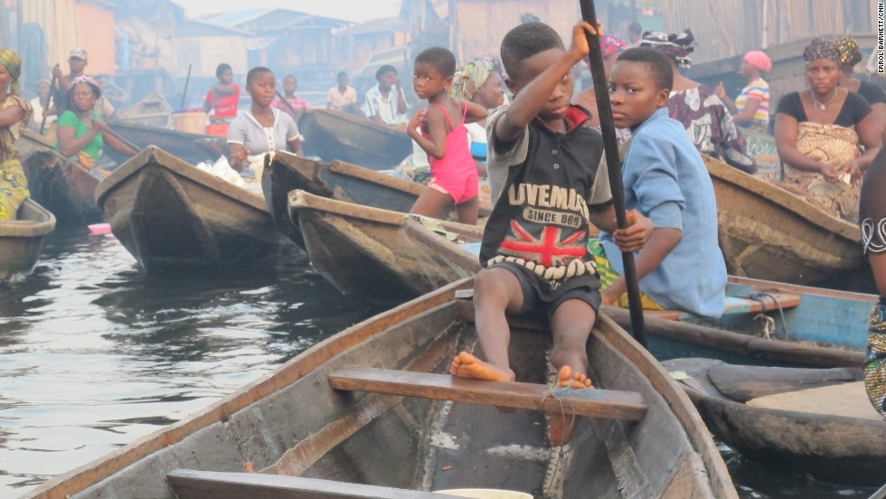 Just like any other bustling town, there's a rush hour in Makoko. Most children appear comfortable steering canoes as it is the only mode of transportation in an all-water community, but they must be careful.