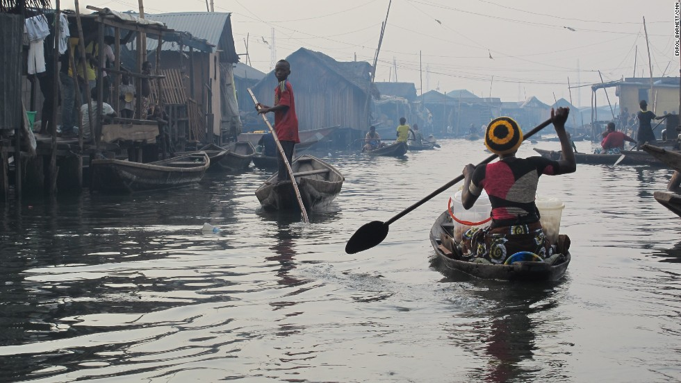 "Nicknamed by some as the ""Venice of Africa,"" the floating village of Makoko in Lagos, Nigeria, is inhabited by people who not only live on water, but also also depend on it for their livelihood."