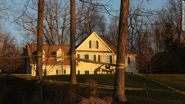 Police tape stretches across the front yard of the Lanza residence on December 19, 2012 in Newtown, Connecticut.