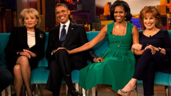 "Walters sits for a photo with President Barack Obama, first lady Michelle Obama and Joy Behar on the set of ""The View"" in September 2012 in New York."