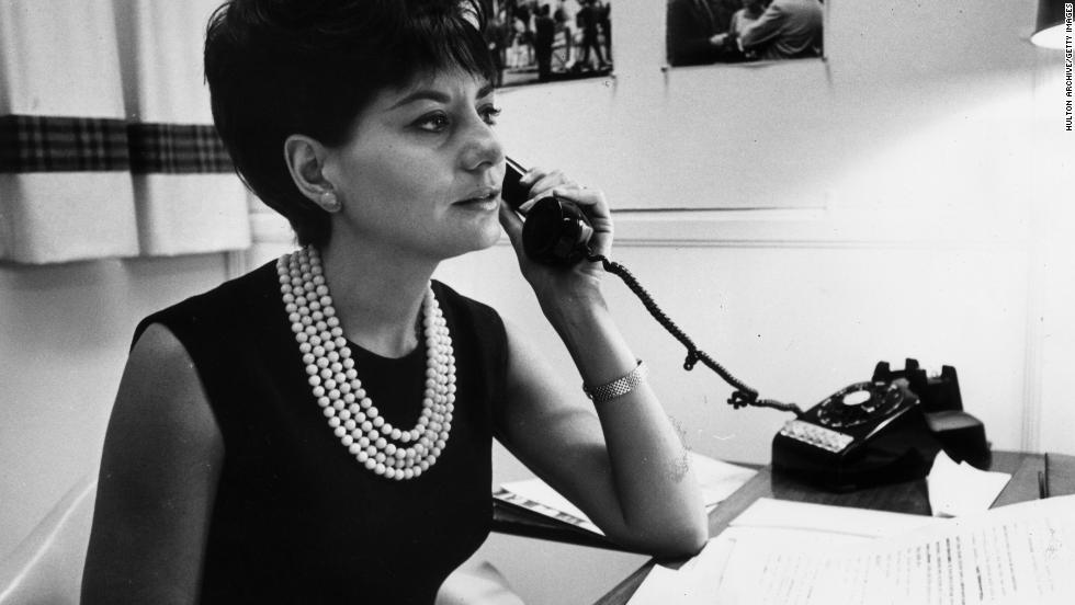 Walters takes a phone call at her desk in New York in 1962.