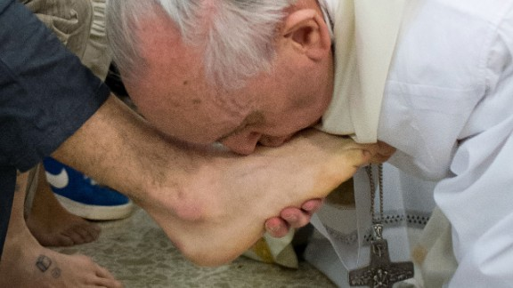 Pope Francis kisses the foot of a prisoner at the Casal Del Marmo Youth Detention Center during the Mass of the Lord's Supper on Thursday, March 28, in Rome.