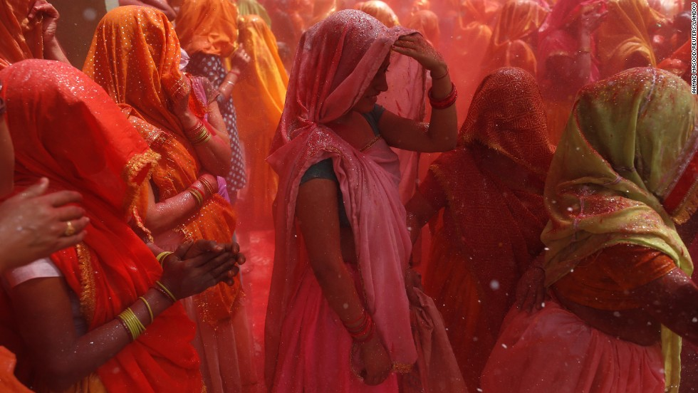 Women take part in huranga at Dauji temple, near Mathura, India, on Thursday, March 28. Huranga is a game played a day after Holi, the Festival of Colors, during which men drench women with colored water and women tear at the men's clothes.