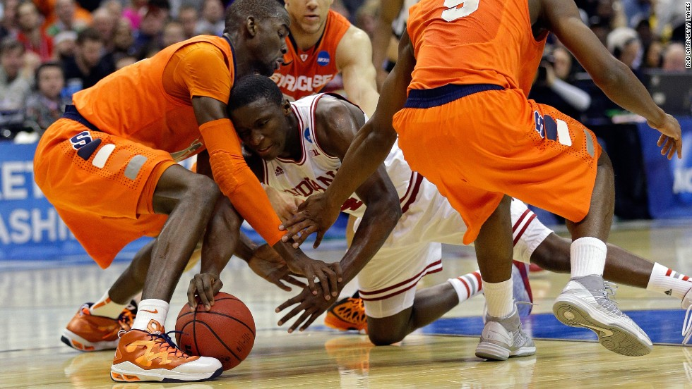 Victor Oladipo of Indiana fights for the loose ball against, left to right, Baye Keita, Brandon Triche and C.J. Fair of Syracuse on March 28.
