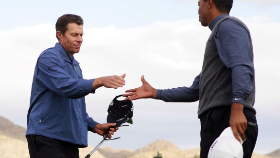 Tiger Woods, right, shakes hands with Nick O'Hern of Australia after O'Hern beat him in the third round of the WGC-Accenture Match Play Championships on February 23, 2007 in Marana, Arizona. The loss ended Woods' streak of seven straight victories.
