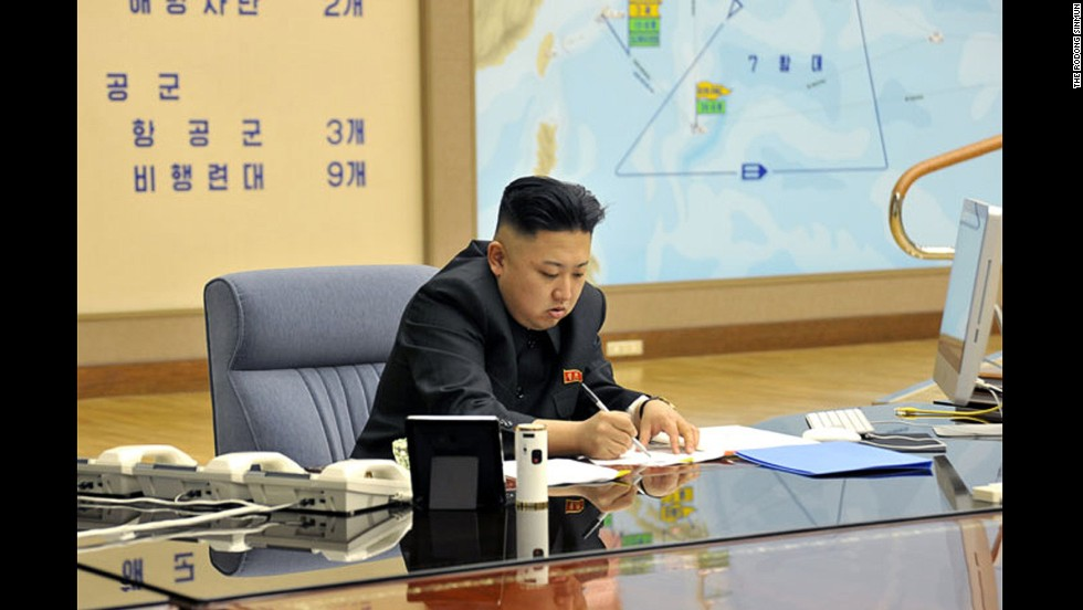 Kim works during a briefing in this undated photo.