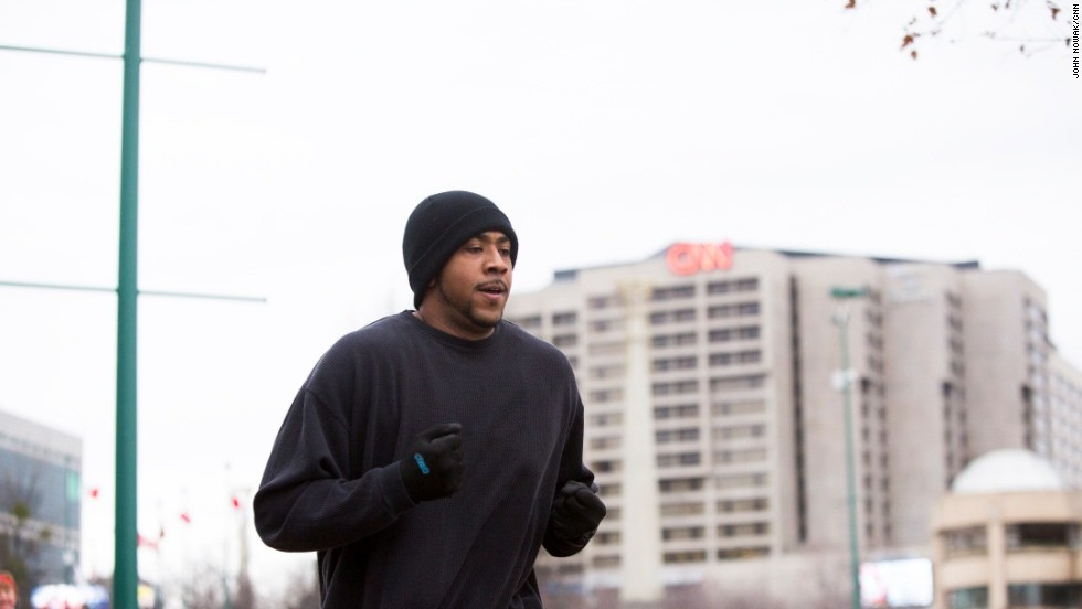Cleveland goes for a run in Centennial Olympic Park outside CNN headquarters in Atlanta.