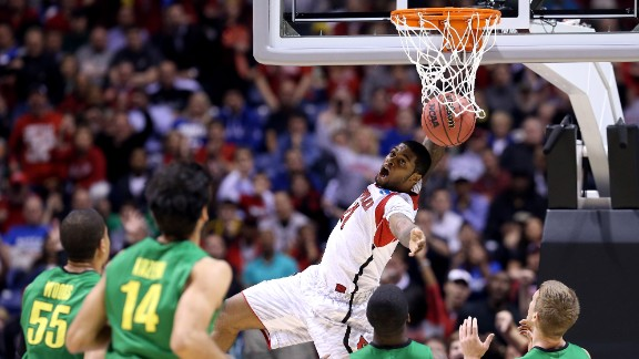 Chane Behanan of Louisville falls back to the floor after dunking the ball on March 29.