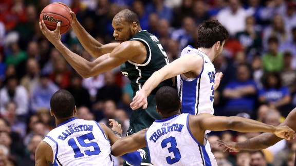 Adreian Payne of Michigan State controls a rebound against, left to right, Josh Hairston, Tyler Thornton and Ryan Kelly of Duke on March 29.