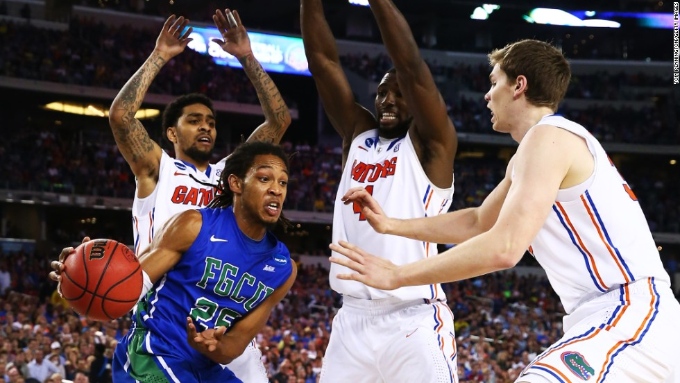 "Sherwood Brown of the Florida Gulf Coast Eagles looks to pass around the Florida Gators on March 29 in Arlington, Texas. Check out the action from the fourth round of the 2013 NCAA tournament and <a href=""http://www.cnn.com/2013/03/23/worldsport/gallery/ncaa-round-of-32/index.html"" target=""_blank"">look back at the NCAA tournament Round of 32</a>."