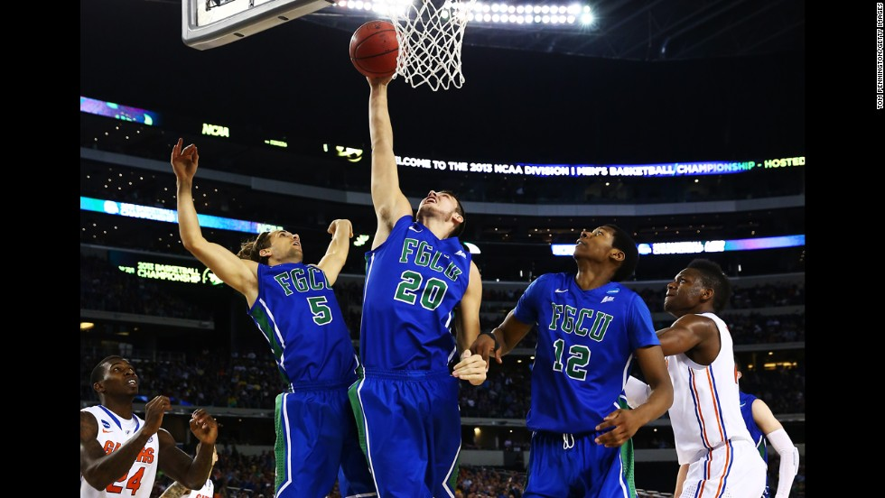 Chase Fieler rebounds between Christophe Varidel, left, and Eric McKnight, right, of Florida Gulf Coast on March 29.