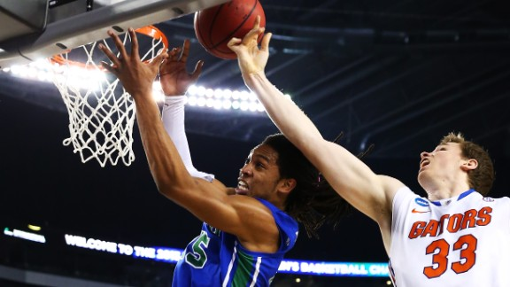 Erik Murphy of Florida, right, and Sherwood Brown of Florida Gulf Coast vie for a rebound on March 29.