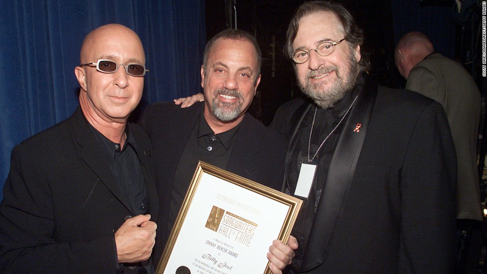 "Music producer and innovator <a href=""http://www.cnn.com/2013/03/30/showbiz/obit-phil-ramone/index.html"">Phil Ramone</a>, right, with Paul Shaffer, left, and Billy Joel at the Song Writers Hall of Fame Awards in New York in 2001. Ramone died March 30 at the age of 72."